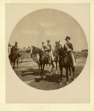 Four uniformed men on horseback