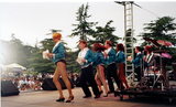 Chorus line on stage at San Diego Pride, 1995