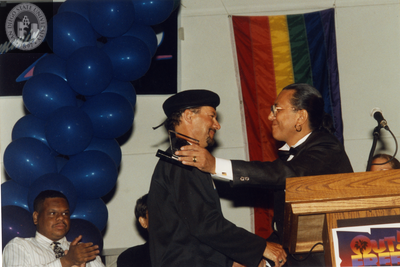Kenny Ard receiving an Out & Free award at San Diego Pride, 1995
